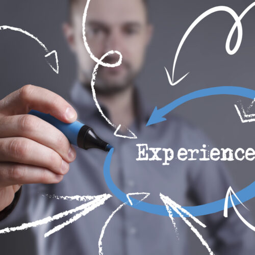 Technology internet business and marketing. Young business man writing word: Experience